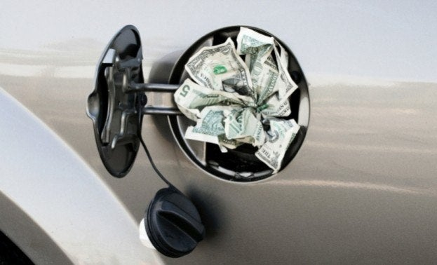 Close Up of Gas Tank full of Money