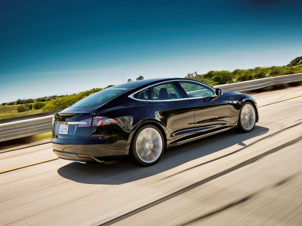 Tesla Model S Black Rear In Motion