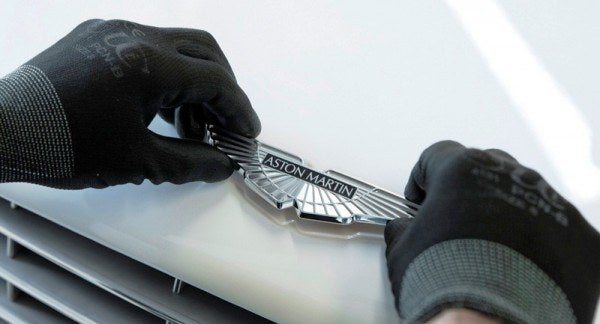 Aston Martin final badge 600x324 A Private Tour of the Aston Martin Factory   Tea & Biscuits