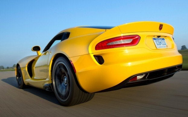 2013 SRT Viper Coupe yellow rear view at speed 1024x640
