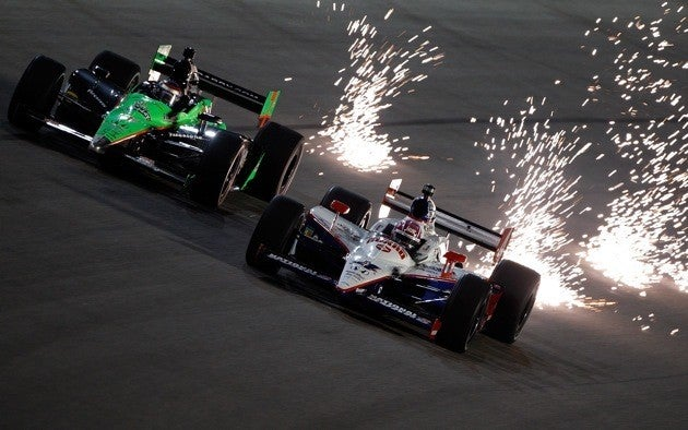 Wheldon battles under the lights