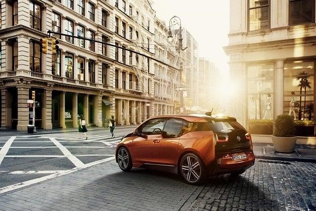 BMW i3 Rear Side Orange on Street BMW Group