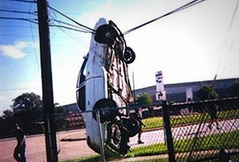 Car hanging from power line