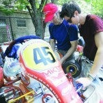 My dad and I working on the kart