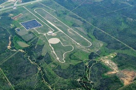 Ariel view of the Cooper Tire and Vehicle Test Center located south of San Antonio on Interstate 35.  Note the wet track - the black square in the upper left corner.