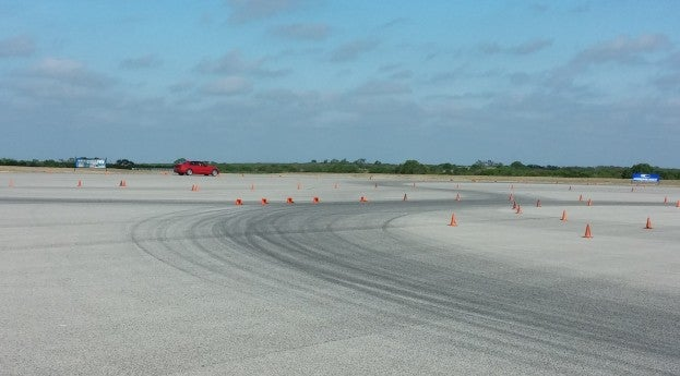Me making a run in the BMW 3 Series with Pirelli Cinturato P7 tires.  Notice the cones just ahead that are knocked over...