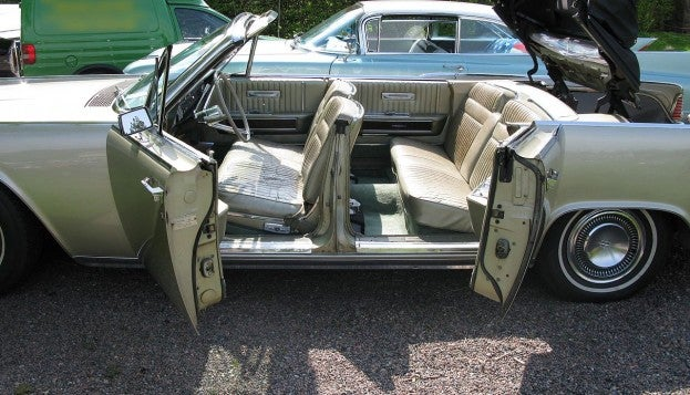 1960s Lincoln Continental convertible with suicide doors open
