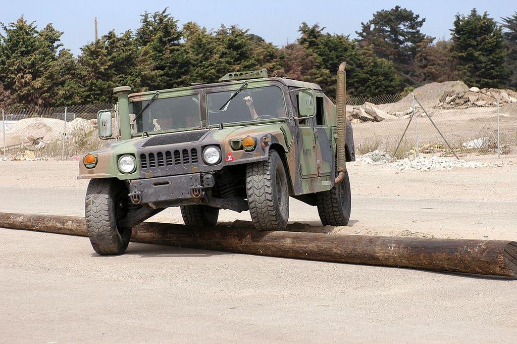 Humvee crossing telephone pole