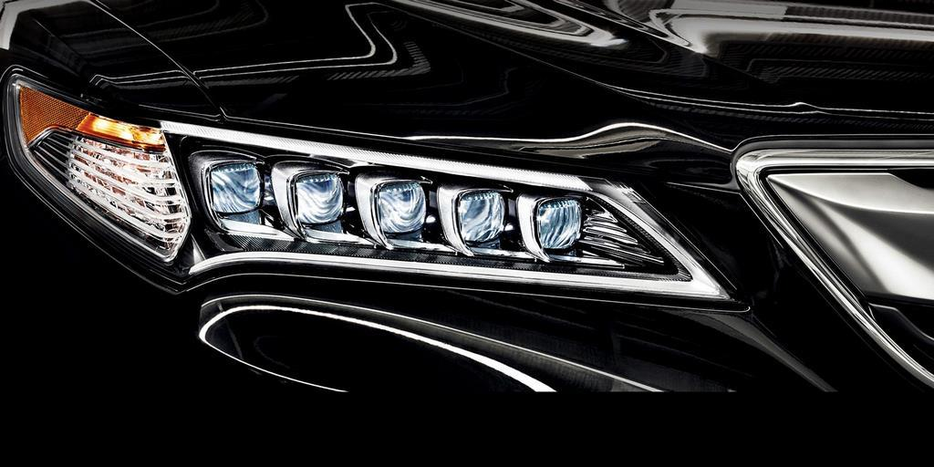 2015 tlx exterior in crystal black pearl headlight cluster