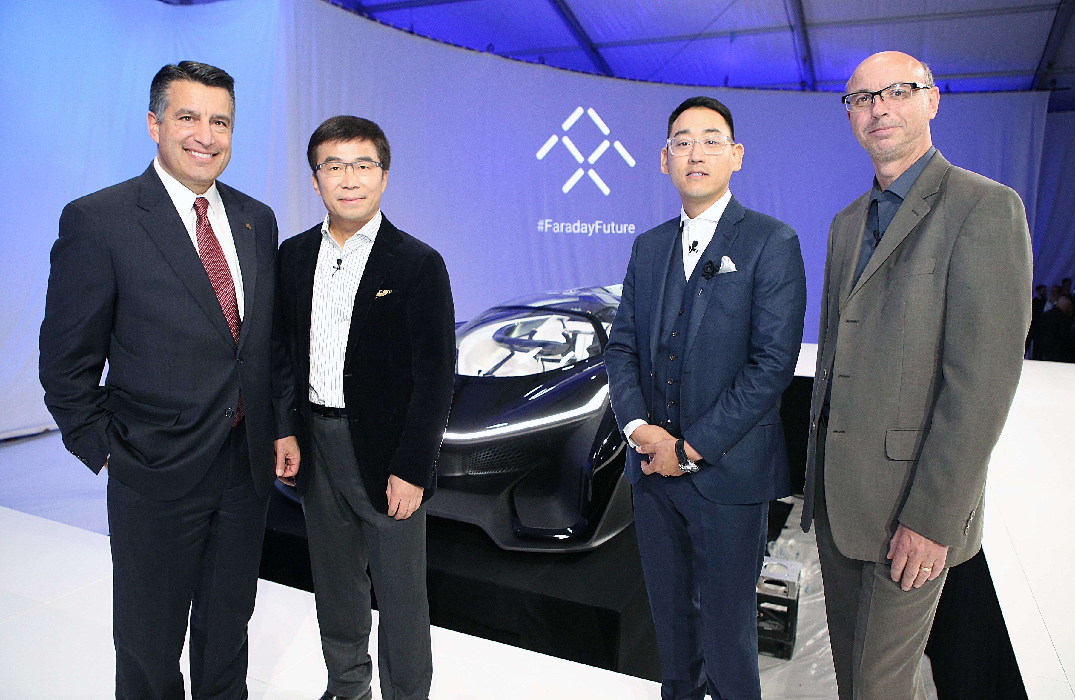 Governor Sandoval, left, Ding Lei, Co-Founder, Global Vice Chairman, Managing Director, SEE Plan, Letv, second left, Richard Kim, Faraday Future Global Design Director, second tight, and Nick Sampson, VP of R&D and Engineering pose for a photo during Faraday Future's pre-CES reveal of FFZERO1 Concept in Las Vegas on Monday, Jan. 4, 2016. (Bizuayehu Tesfaye/ AP Images for Faraday Future)