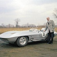 Bill Mitchell poses with his 1959 Stingray, a car originally built for racing but which Mitchell later used for his daily commute to the GM Design offices.