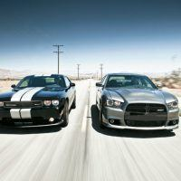 The touchstones for the essence of the Dodge brand are the Challenger (left) and Charger (right). These models are designated to carry the division's special 100th anniversary edition packages, were produced in 2014.