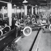 The Dodge Main assembly in 1916 adopted the moving assembly line pioneered by Henry Ford at his nearby Highland Park plant. Inset: Cars await shipment from Dodge Main. Dodge Brothers used steel bodies and enamel paint that could be cured in ovens, significantly shortening the time it took to produce cars.