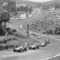 "Belgian GP Spa June 22, 1952 The field rushes through Eau Rouge on lap one of the Belgian GP led by Ascari and Farina, pursued by Jean Behra's Gordini, Mike Hawthorn's Cooper-Bristol, Ken Wharton's surprisingly effective Frazer Nash FN48, and Stirling Moss in the ugly and unsuccessful ERA G-type. Ascari won the race easily from Farina with Robert Manzon 3rd for Gordini and Hawthorn 4th despite stopping twice for fuel caused by a leaking tank. The demise of Alfa Romeo's racing team and the failure of BRM's V16, the obsolescence of the Talbot Lagos, Maseratis, assorted ERAs, and other even less-likely machinery, left only Ferrari (and soon Maserati) with viable cars. Thus the 2-liter F2 championship came about, supposedly as a temporary measure as organizers wanted the big cars, but in reality the 1.5-liter s/c and 4.5-liter unblown cars were consigned to lesser events and eventually history. This suited Enzo Ferrari, who had an already-developed a 4-cylinder racer, the 500, and Alberto Ascari backed up by ""Nino"" Farina and others. The competition was led by Maserati, whose 6-cylinder A6GCM was almost a match for Ferrari, with Gordini, Connaught, HWM, Cooper, et al. making up the numbers."