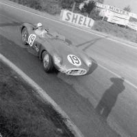 "Le Mans June 11 and 12, 1957 Aston Martin entered three team cars at Le Mans plus Jean Kerguen's ""customer"" DB3S. Two of them were the DBR1/300s for Tony Brooks/Noel Cunningham-Reid (DBR1/2) and Roy Salvadori/Les Leston (DBR1/1). This is Les Leston (1920–2012) rounding Mulsanne corner with Klemantaski's shadow making a guest appearance on film. The car retired after 112 laps with a fractured oil pipe."