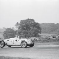 Donington GP October 2, 1937 Bernd Rosemeyer was the fastest man on a GP grid and the 6-liter 520 bhp V-16 Auto Union a formidable weapon if you could handle its rear-weighted bias and swing-axle rear suspension. Nevertheless, Manfred von Brauchitsch's Mercedes-Benz W125 might have won, but a rear tire blew at 160 mph on the Starkey Straight and he had to settle for second place. Rosemeyer flies over the Melbourne Rise on his way to victory. Unlike the Mercedes, which took off front end first, the rear-engined Auto Unions lifted off at the rear.