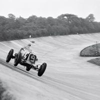 JCC 200 Brooklands August 27, 1938 In 1938 Britain, obsolete GP Maseratis, Alfa Romeos, and Bugattis were good enough to win or finish in the top three in most domestic races, their main opposition being the 1.5- and 2-liter ERAs and voiturette class Maseratis. These once-great cars were both obsolete and beginning to wilt, especially given the type of punishment you can see inflicted here. Bira, with engine cover flapping open, goes airborne around the Members' banking in the White Mouse Garage's Maserati 8CM (3011) to finish second behind Johnny Wakefield's ERA, in a race he would have won but for fading brakes.