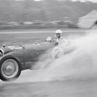 JCC International Trophy Brooklands May 6, 1939 Evans finished 3rd in the International Trophy with his ex-Nuvolari Alfa Romeo P3. It rained heavily during the race, and here Evans motorboats in the sort of conditions that today would induce mass panic in officialdom.