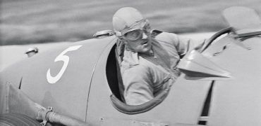 Campbell Trophy Brooklands August 7, 1939  Robert Arbuthnot, born into a Scottish banking dynasty and educated at Eton and Cambridge, was typical of the wealthy amateur British racing driver of the period. He looks a trifle alarmed here as he manhandles his recently purchased ex-Reusch Alfa Romeo 8C35 (50013) around the Campbell circuit at Brooklands. He proved very fast in the race and was in 4th place at one point before spinning and having to restart at the back of the field. Arbuthnot (1914 -1946) raced very little before the outbreak of World War II, after which he bought one of the 1939 Le Mans Lagonda V12s which he unsuccessfully attempted to qualify at Indianapolis in 1946. He owned High Speed Motors in partnership with A. V. Wallington at Watford near north London. Ironically, having survived the war, he was killed when an oncoming Buick went out of control and hit his Peugeot head on.