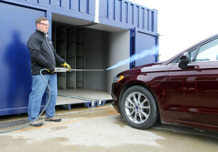 A Ford engineer at work with the mobile wind tunnel. Photo: Ford Motor Company