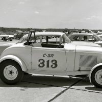This is what a typical Southern California '32 Ford hot rod looked like back in the day. This one was photographed in 1962 at fifth-mile drags in Virginia Beach, Virginia, running 79.53 miles per hour in the 14s. Owned by Joe Montgomery, its power came from a 100-horsepower, 292-inch flathead with a single carb. Photo by Martyn L. Schorr.