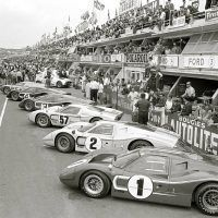The Ford pits prior to the start of the 1967 24 Hours of Le Mans. Dan Gurney and A. J. Foyt drove the Mark IV J-6 in the foreground to the win. It was the first time an all- American car had won at Le Mans. Ford Motor Company