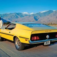"Evidence indicates that this yellow 1971 Boss 351 started out as a Boss 302, possibly 1F02G100053, before the decision was made to discontinue the small displacement Boss Mustang. The car was used for a series of publicity photos. The ""5"" and ""1"" on the decals appear to have been retouched to revise the ""302"" lettering to ""351."" Ford Motor Company Photo"