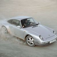 A chance to test drive the new Carrera 4 proved irresistible even to world rally champion Carlos Sainz. The 993 C4 appeared as a late 1994 model. Porsche Archiv