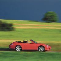 With its wind deflector in place, the 996 Cabrio showed off the graceful lines Pinky Lai had labored to produce. Cabrio buyers received an aluminum hardtop as part of their purchase price. Porsche Archiv