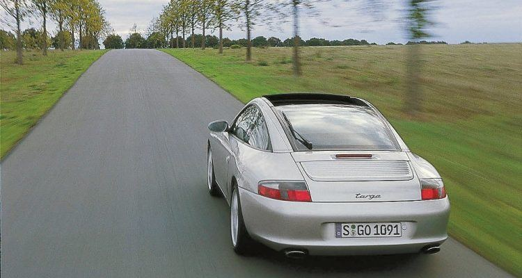 After some tough challenges with the 993 glassroof Targa, Weissach body engineers reconfigured the entire concept for the 996. This new top system mounted to the car body from the inside and the rear window operated like a hatchback. Porsche Archiv