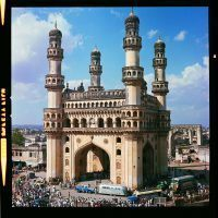 We can spot Andy Charles' Ford pick-up and Airstream trailer parked in front of a fabulous building, which is the Charminar (sometimes spelled Char Minar) a monument and mosque built in 1591 Hyderabad, Telegana, India. Charminar means Four Towers in the Urdu language.