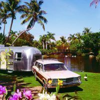 The always-popular Ford Country Squire station wagon was another ideal tow vehicle in the 1960's and 1970's. This 1967 model is towing an Airstream in beautiful Hawaii!