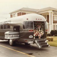 Here's the exterior view of the Airstream Funeral Coach, circa 1982. It was a decent idea, having one vehicle that could take the place of several. The flowers went into the rear hatch area, as shown, while the casket went into the side carrier space. Mourners rode inside the spacious passenger compartment, which was nicely trimmed and featured individual seats plus a couch at the rear.
