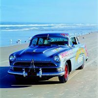 This 1954 Hudson Hornet equipped with full Hudson NASCAR racing kit—Twin-H engine and heavyduty suspension and brakes—was discovered in North Carolina near the home of NASCAR legend Herb Thomas and is thought to have been a backup car for Thomas' fabled No. 92 Fabulous Hudson Hornet.