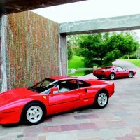 "With those stunning looks, extremely limited production numbers, and a realistic claim on being the world's fastest production car, the 288 GTO was the first ever ""instant collectible""—a motorcar that has never sold for less than its original price. The 288's resemblance to the 308 GTB is quite evident in this image. Both were Fioravanti designs, the 288's longer wheelbase, flared fenders, and upturned tail only accentuating an already beautiful shape. Photo by Winston Goodfellow"