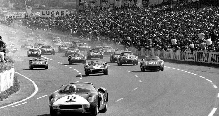 Pedro Rodriguez bursts into the lead in his Ferrari 275 P at the start of the 24 Hours of Le Mans in 1964. Five minutes from now, Richie Ginther, on the far left in No. 11, will be in the lead.