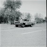 A-990 Hemi drag cars with radically altered wheelbases started showing up at tracks toward the end of 1964. The idea originated as a design experiment by Chrysler research and racing engineers; 12 cars were built for Chrysler-sponsored drag racing teams. Here's Dick Landy playing with his in a parking lot. Archives/TEN: The Enthusiast Network Magazines, LLC