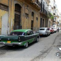 Just a few blocks from the elegant Parque Central, this is a typical street scene. The 1957 Plymouth and 1955 Cadillac are parked next to once-elegant buildings, now in need of restoration.