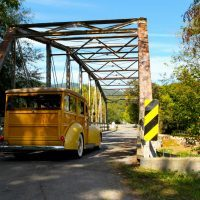 Driving the Woody east across a quaint bridge on a beautiful autumn day was one of many pleasures of the Barn Find Road Trip.