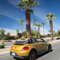 2016 Volkswagen Beetle Dune Rear Profile Driving