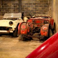 Although these Triumph TR3s are rough, there are enough of them that at least one complete car could be fabricated. Additionally, the owners of British Auto Restorations have loads of spare parts for Triumph.