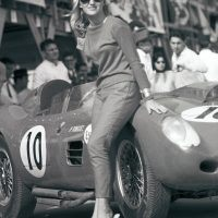 This unidentified beauty poses against Wolfgang Von Trips's Ferrari 315S prior to the start of the 1958 Grand Prix. Perhaps she rubbed on some good luck, because Von Trips finished fourth.
