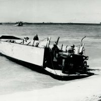It took great courage to overcome one's fears and drive off a landing craft under fire, but many a young man had to do it. Notice the snorkels mounted on the Jeeps; these are for fording deep water.
