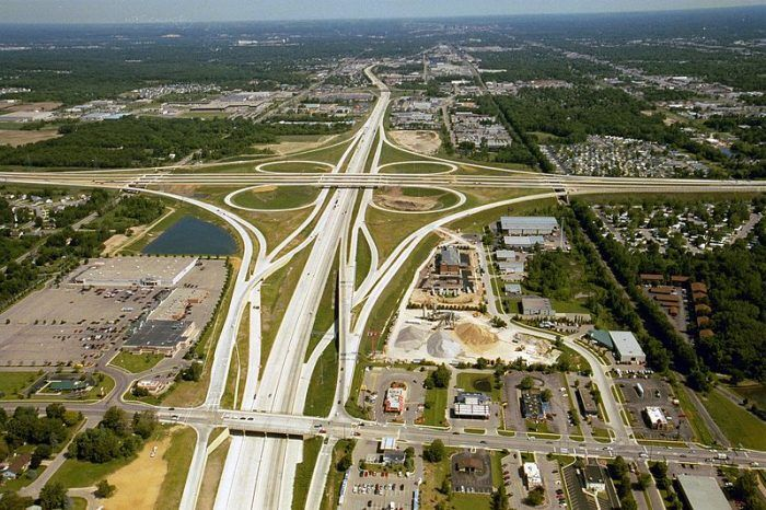 According to TRIP, Michigan's roads and highways carried 95 billion vehicle miles of travel in 2012. Aerial photo of the US 131/M-6/68th St. interchange in Wyoming, MIchigan looking north. Photo: Michigan Department of Transportation.