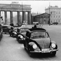 Volkswagens cruise through Berlin in 1939. Note that the cars now have fronthinged doors. Ferry incorporated the design in 1937 after returning from his trip to America, where he observed that most U.S. cars were built in this fashion. Photo: Porsche Werkfoto.