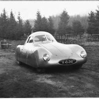 From drafting board to sheet metal, the evolution of the first Porsche-designed sports car, the Type 64 60K10, took about a year. The result was three examples of the higher-performance Volkswagen platform surrounded by Komenda's streamliner body. The contours that would become the Porsche 356 can be seen in these 1939 photos. Photo: Porsche Werkfoto.