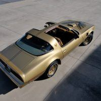 "Finished in Anniversary Solar Gold, the 1978 Gold Edition Trans Am was a very rare version of the T/A. Gold ""snowflake"" wheels were part of the package from the factory."