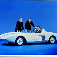 "Ford teased sports car fans in 1962 with a two-seat Mustang prototype. The name became ""Mustang I"" in 1963 after the Mustang II show car was unveiled. Standing left to right are engineering vice president Herb Misch and design chief Gene Bordinat. Chassis engineer Roy Lunn is at the wheel. Photo: Ford Motor Company."