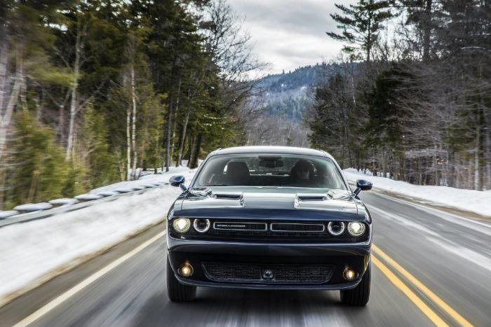 Dodge Challenger driving on snowy road
