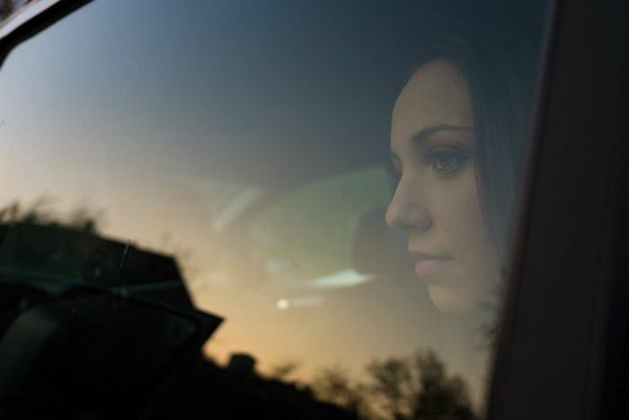 girl sitting in a car PNSR3NX